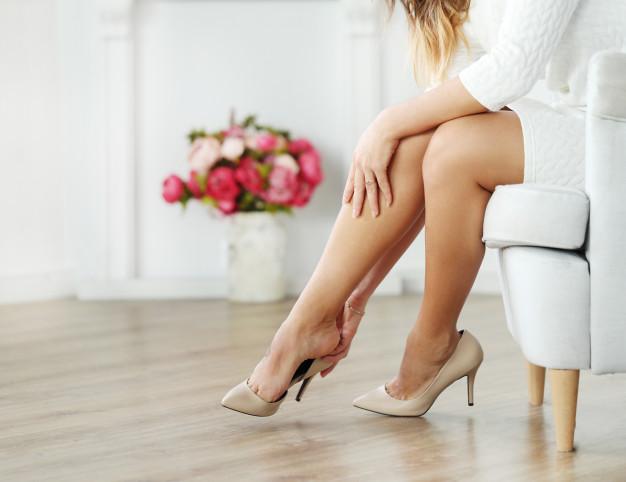 woman-sitting-armchair-wearing-beige-heels_144627-23568